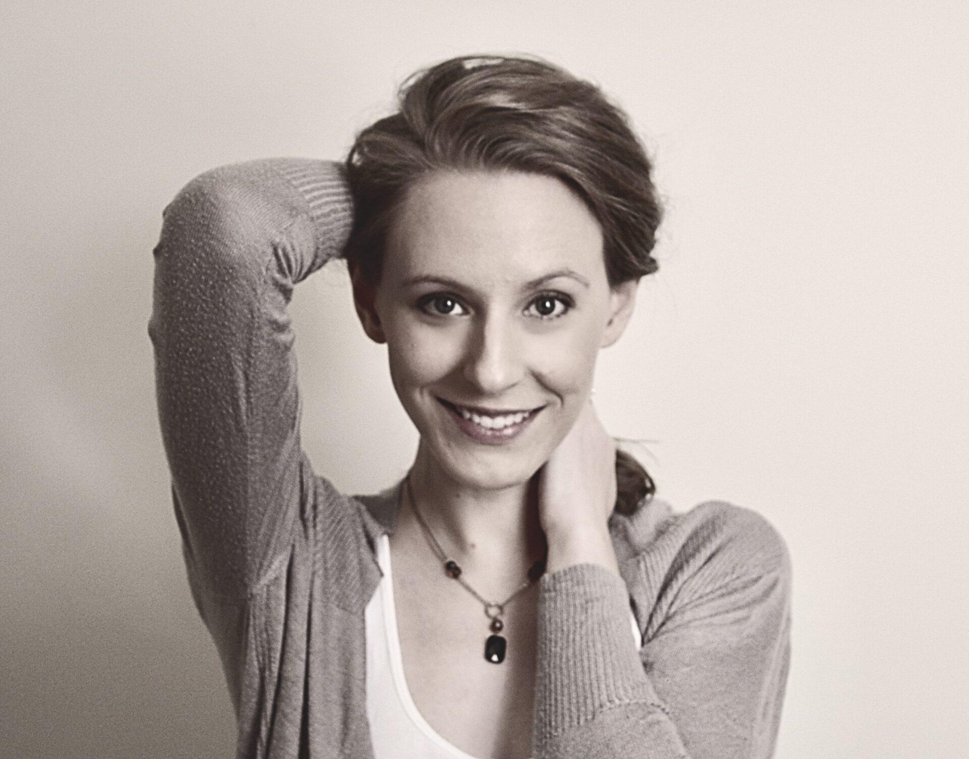 Melanie Lorick Hair Half-up looking at camera