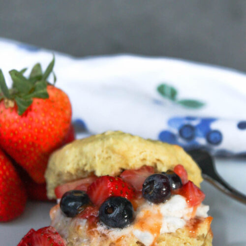 Strawberry shortcake with blueberries on plate | hearth health happiness