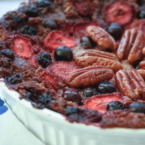 close-up of baked oatmeal with strawberries, blueberries, and pecans   hearth health happiness
