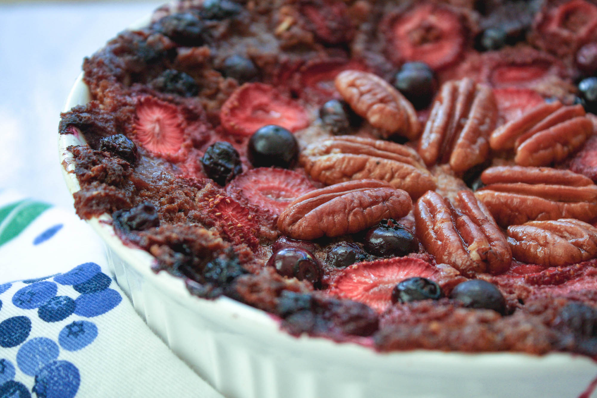 close-up of baked oatmeal with strawberries, blueberries, and pecans | hearth health happiness