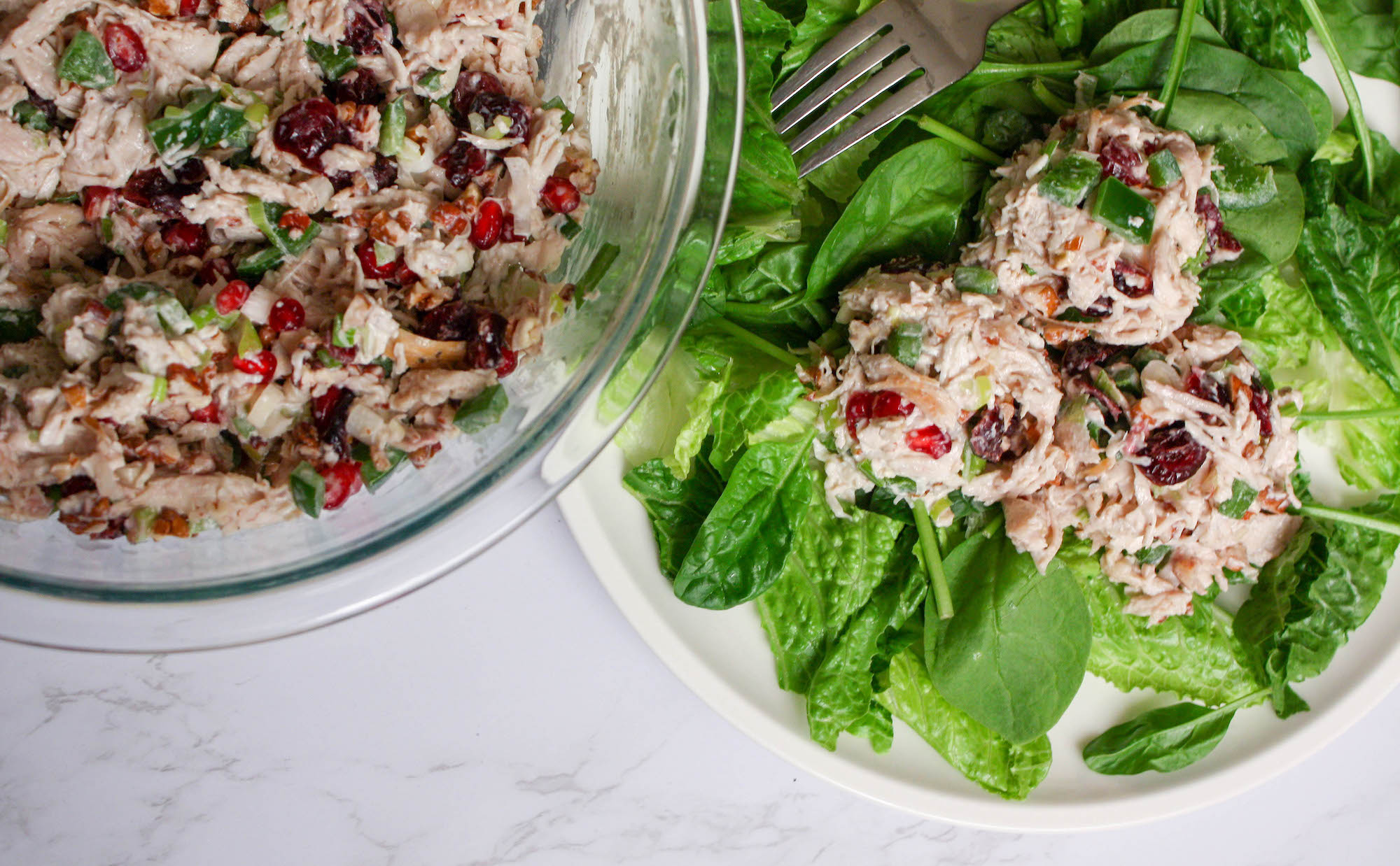 overhead image of chicken salad in bowl and on a bed of lettuce | hearth health happiness