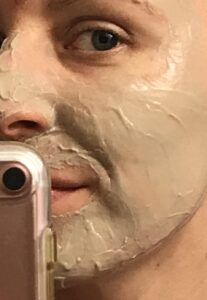 Close-up of cheek with bentonite clay face mask applied | hearth health happiness