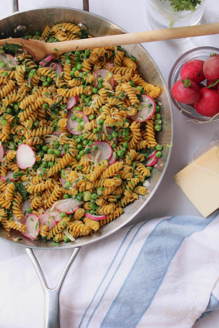 sauteed radish and green pea pasta in skillet