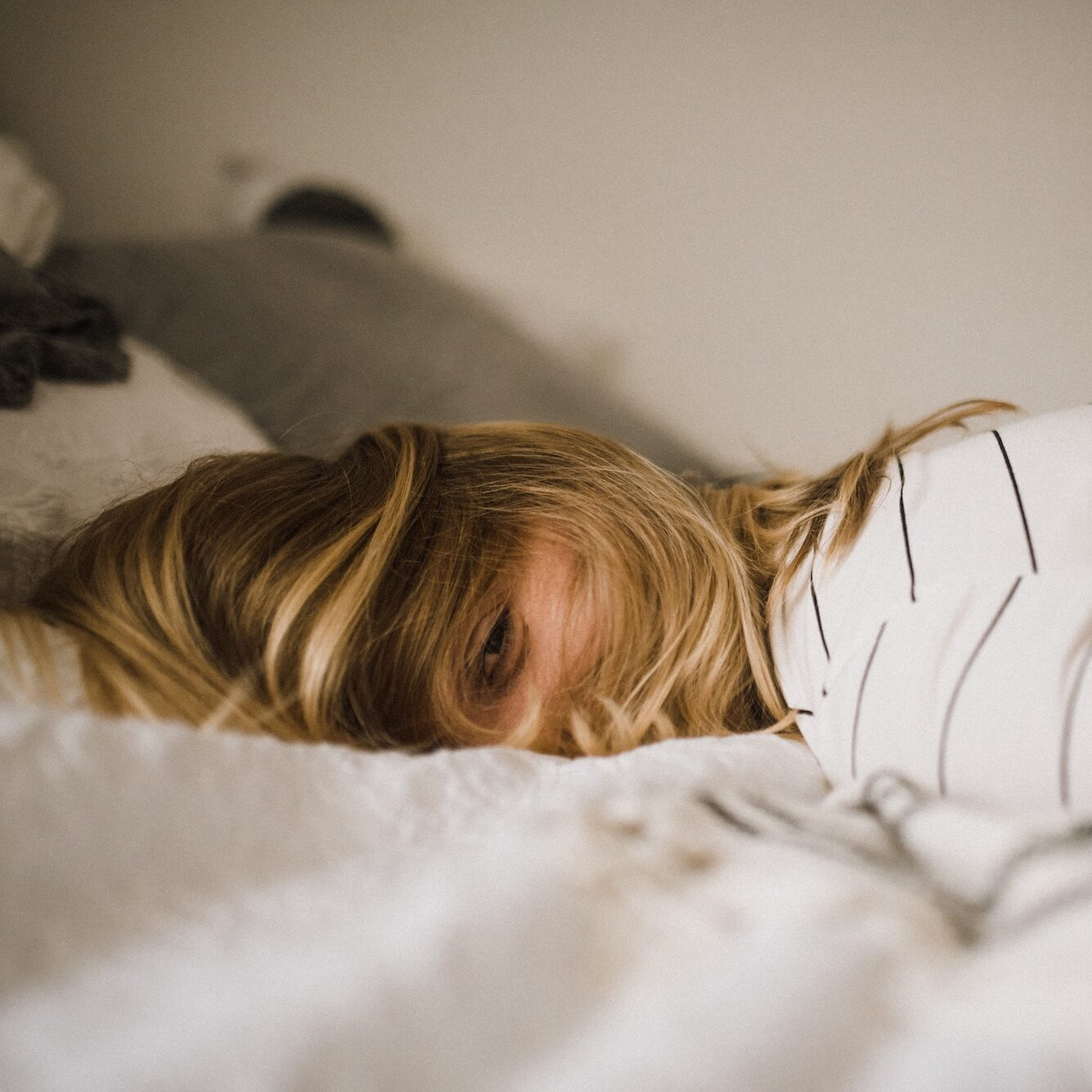 female napping on bed | lifestyle | Photo by Kinga Cichewicz on Unsplash | hearth health happiness