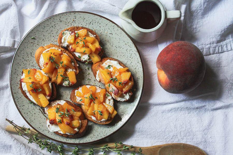 overhead image of peach crostini on table