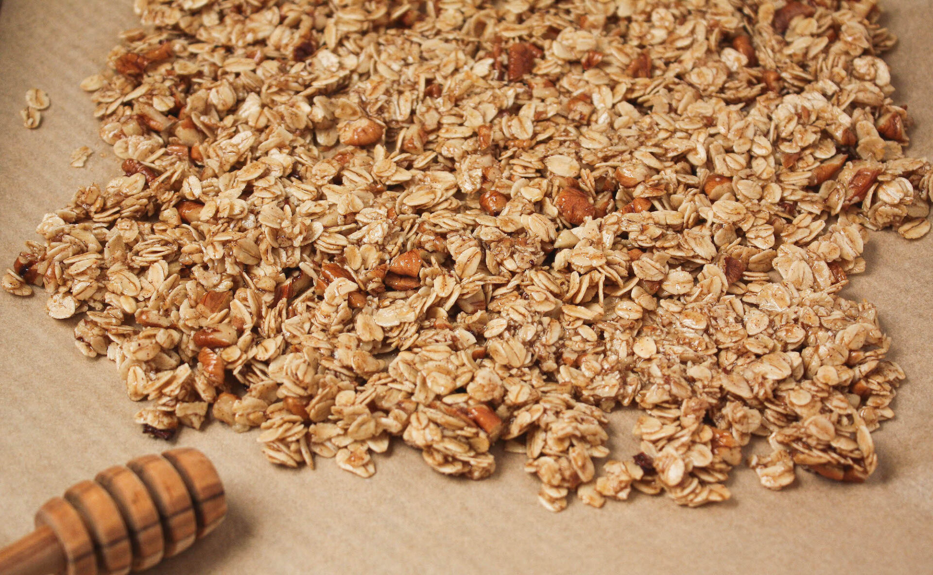 raw granola before baking on parchment paper | homemade granola | food blog | hearth health happiness