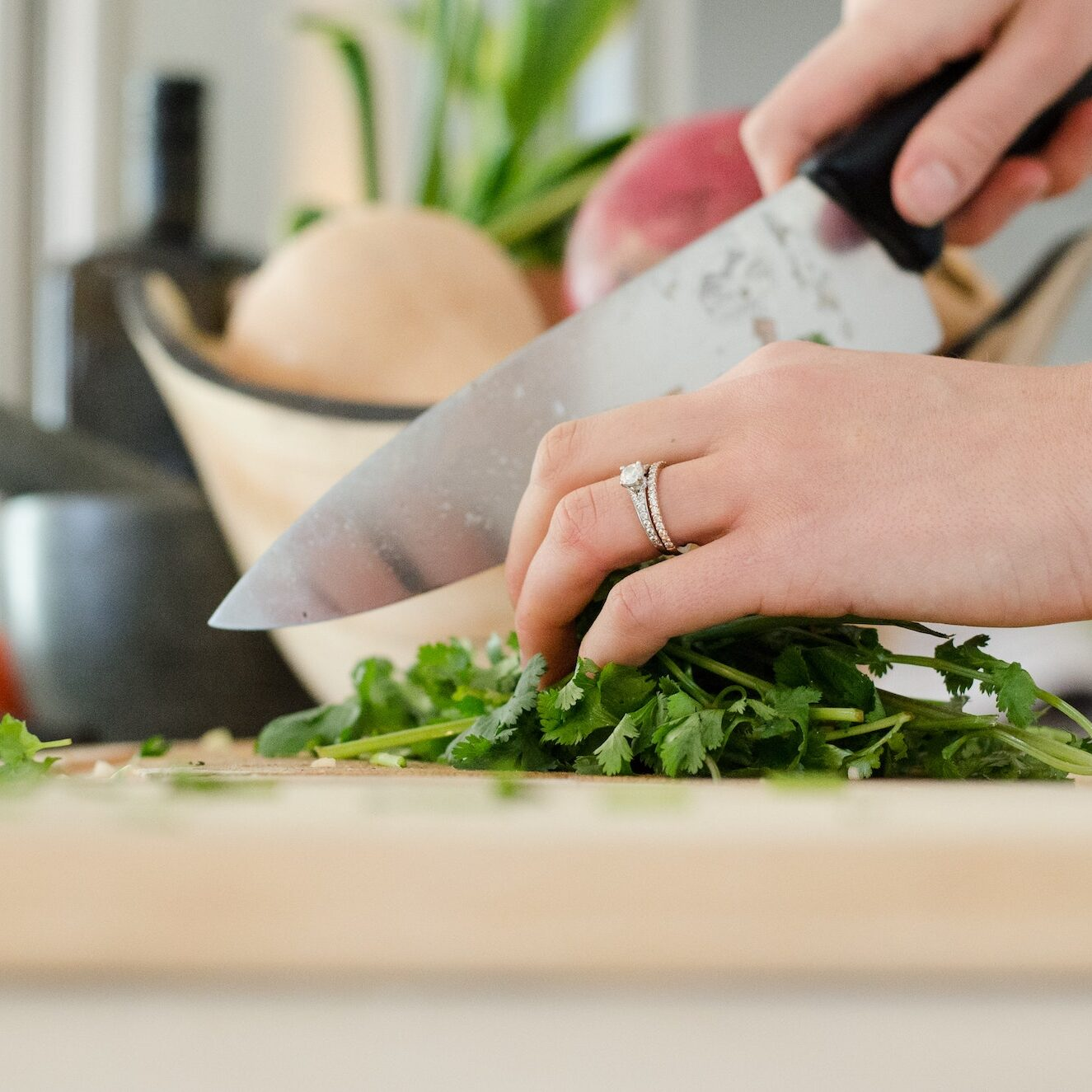 chopping herbs | food blog | Photo by Alyson McPhee on Unsplash | hearth health happiness