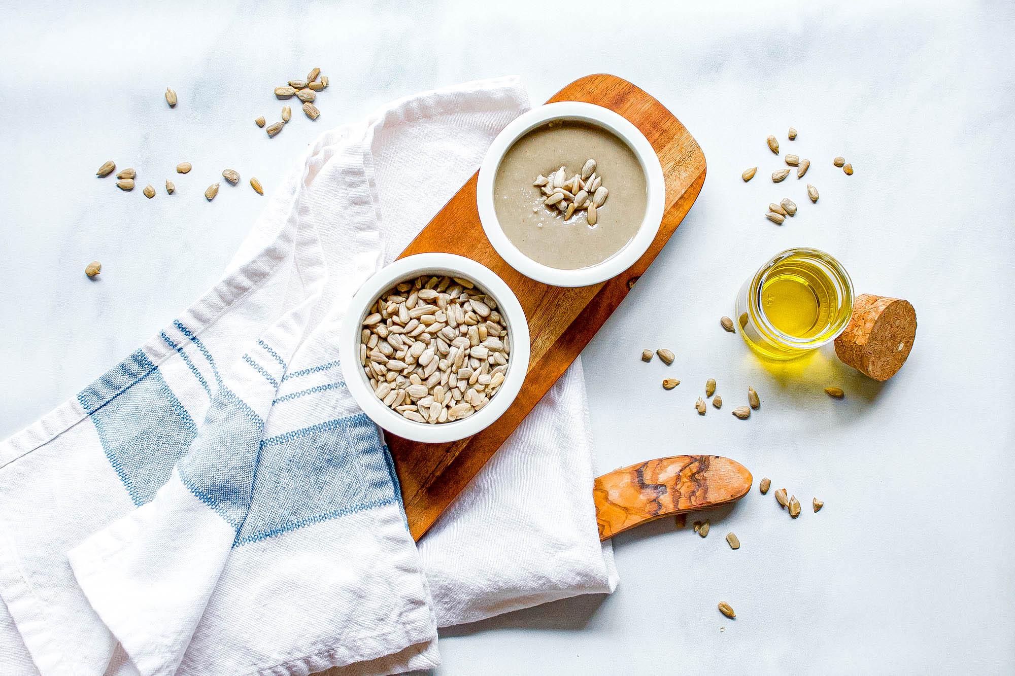 overhead image of sunflower seeds and sunflower seed tahini | food blog | hearth health happiness