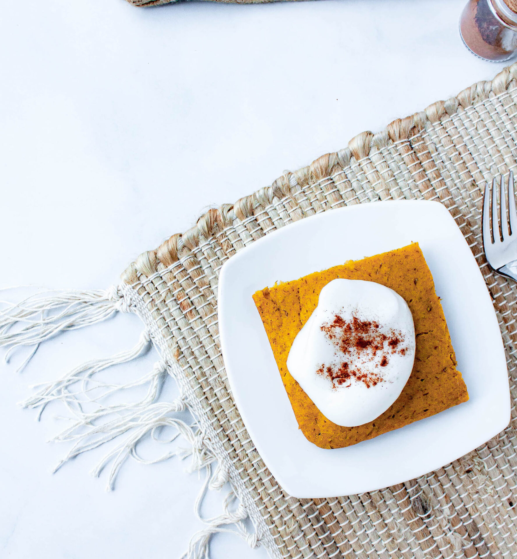 overhead image of pumpkin spice pancakes with aquafaba whipped cream | hearth health happiness