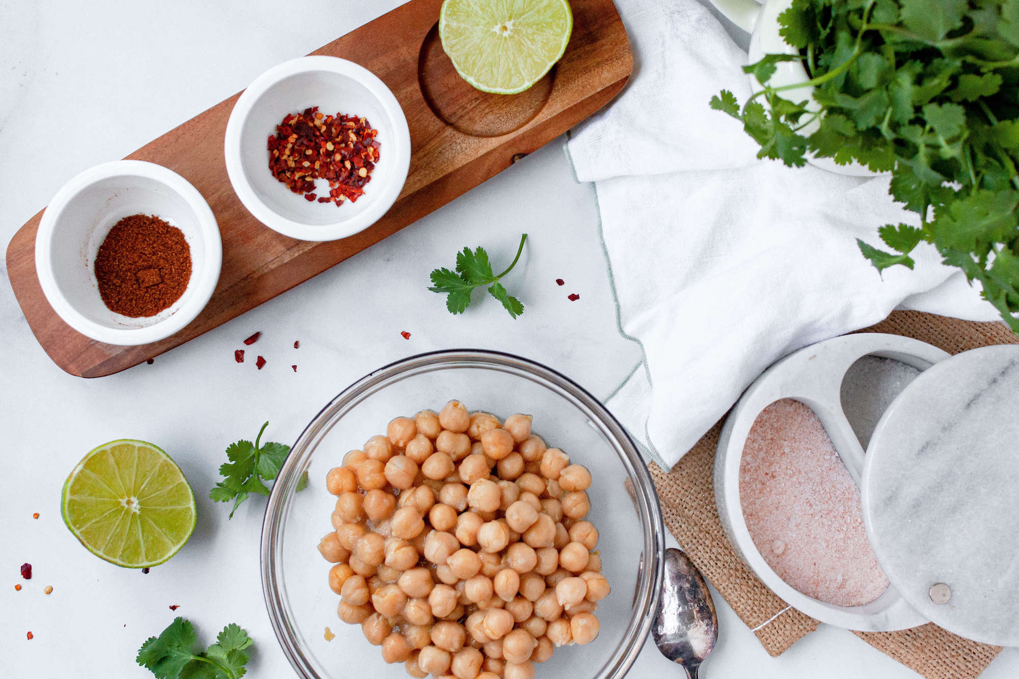 overhead image of plain chickpeas with the seasoning ingredients | hearth health happiness