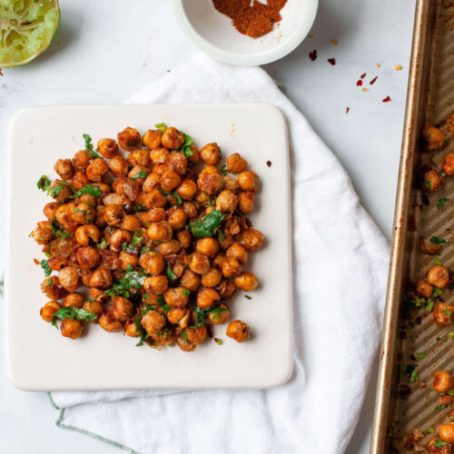 chili lime roasted chickpeas on plate with adjacent baking sheet | flexitarian diet