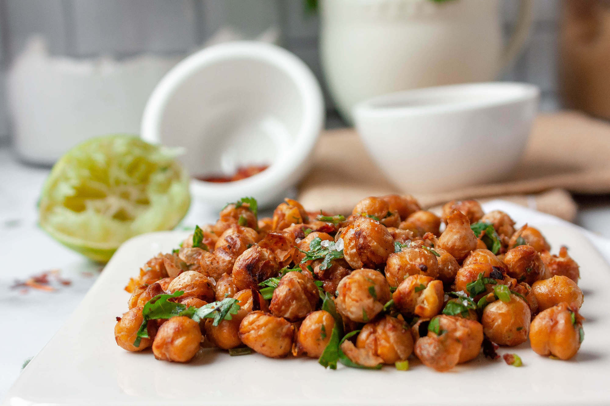 side angle shot of chili lime roasted chickpeas on serving plate