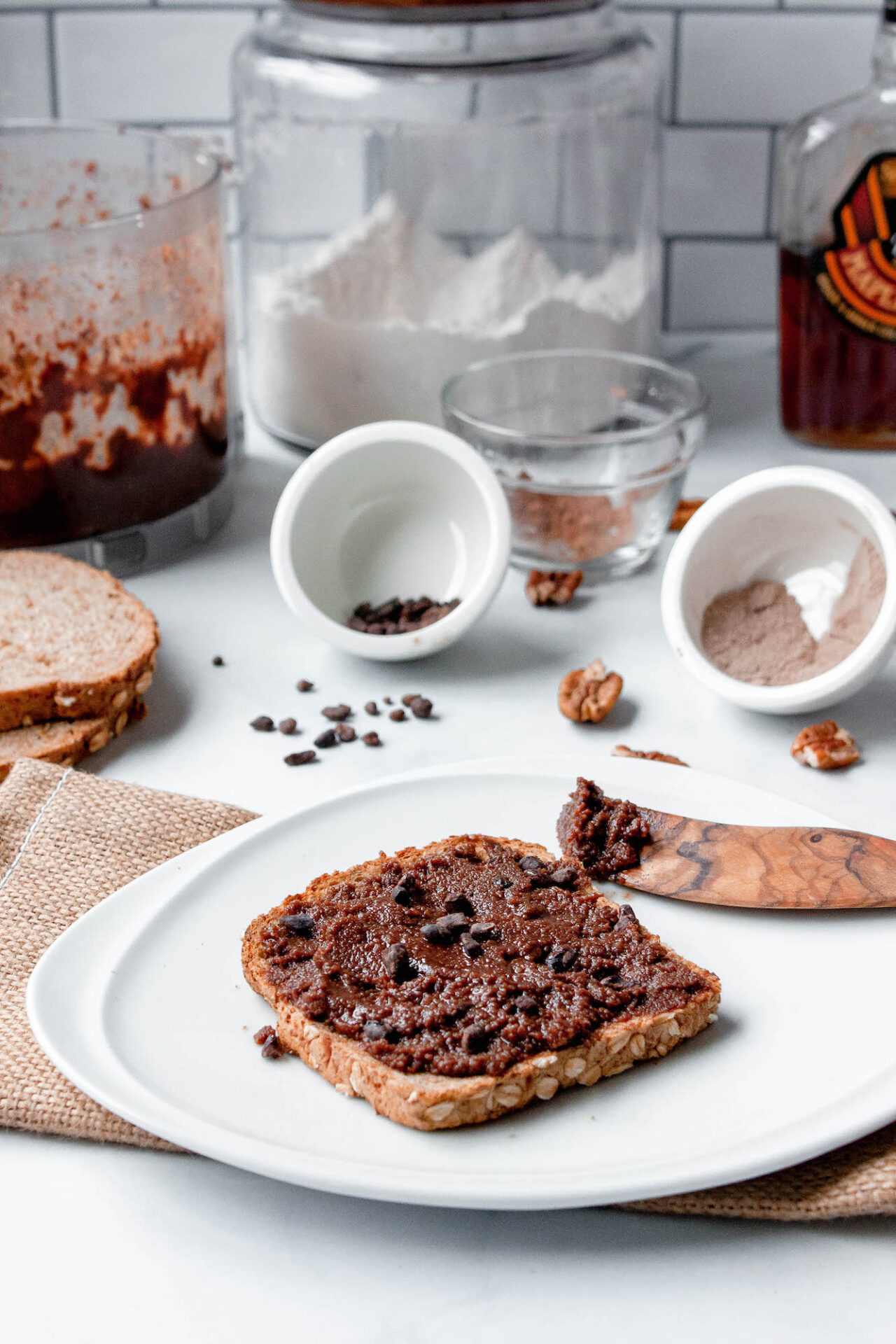 triple chocolate pecan butter vertical image on counter with toast   flexatarian recipe