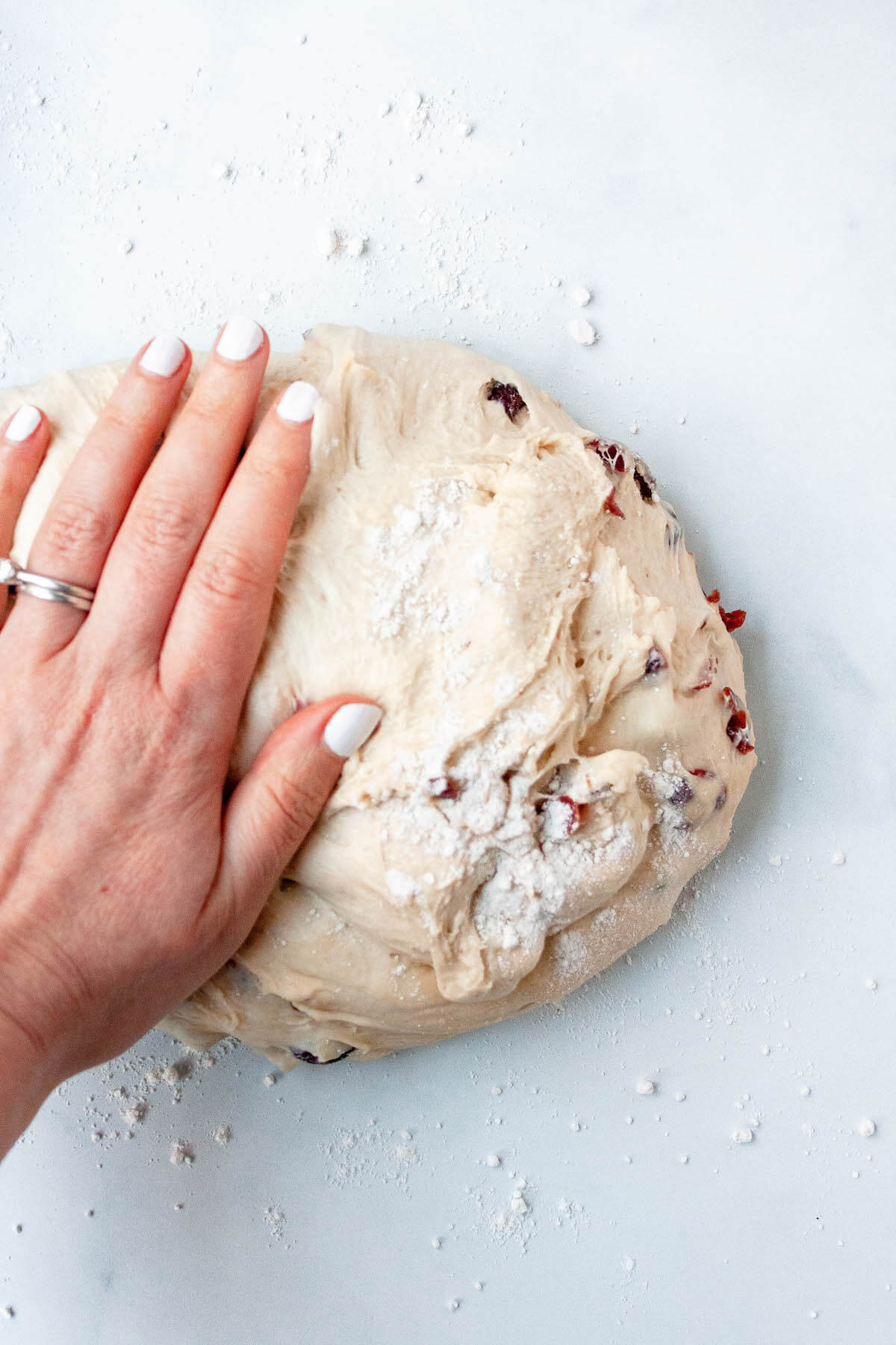 cranberry boule bread kneading on counter
