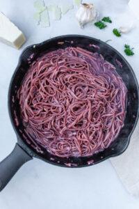 gluten free red wine pasta in a cast iron skillet