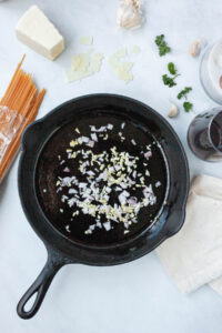 cast iron skillet with garlic and shallot