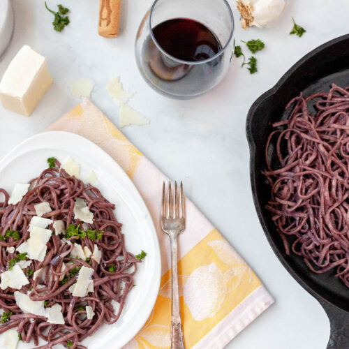 gluten free red wine pasta on counter with scattered ingredients
