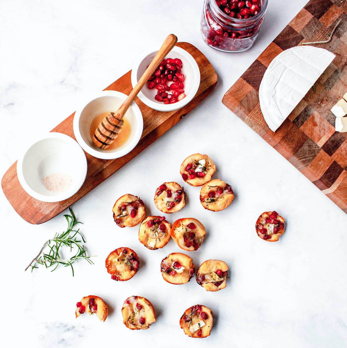 overhead image of pomegranate rosemary brie bites on counter