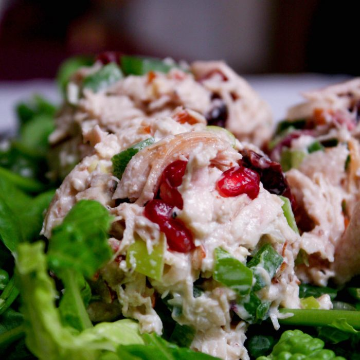 Close-up image of chicken salad scoop on bed of lettuce | hearth health happiness