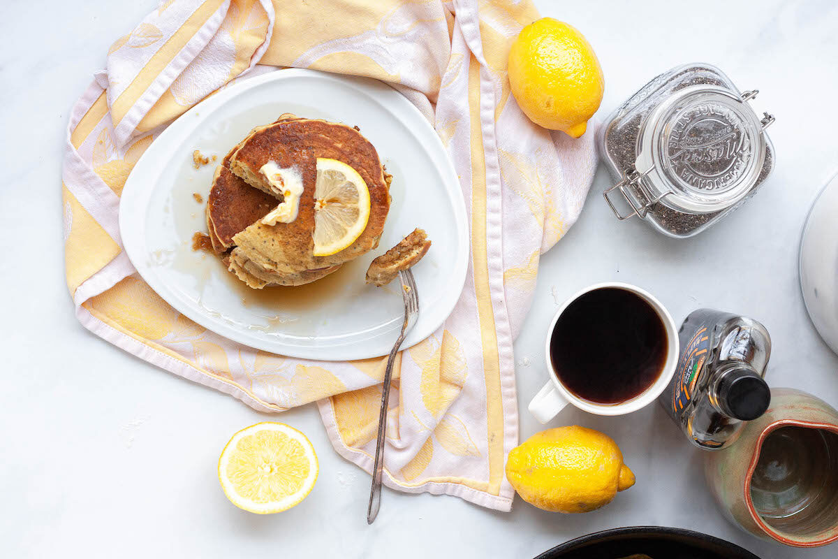 overhead image of lemon poppy seed pancakes and coffee on counter